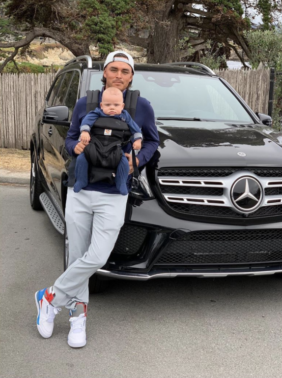 Rickie Fowler and a baby